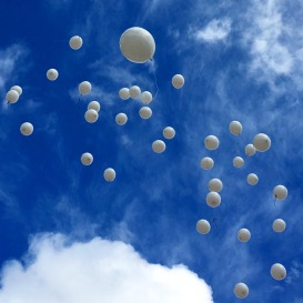 The day we let a hundred white balloons fly for our beloved