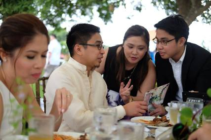 The couple talking to the event hosts, our cousin Mia and our youngest brother Jose (Photo by Sarah Mendoza)